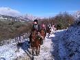 Paseando a caballo sobre la nieve