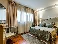 Sansi-diputació-habitación-con-mobiliario