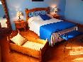 Casa-rural-valdrefresno-habitación-cama-doble-y-cuna