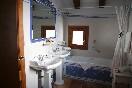 Twin sinks, hidden toilet and hidromassage bath tub