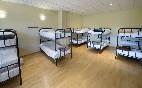 Habitación múltiple con baño compartido, ideal para grupos y familias