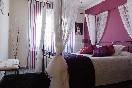 Habitación con cama de matrimonio del apartamento