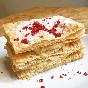 Milhojas de chocolate blanco y pistacho con frambuesas