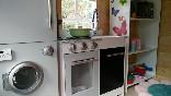 La-casa-encantada-caista-del-jardín-cocina
